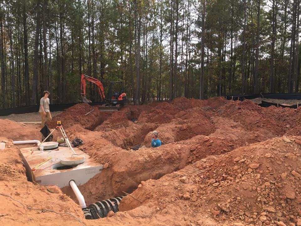 Commercial septic tank and drain field new septic line installation by Donavens Septic Service